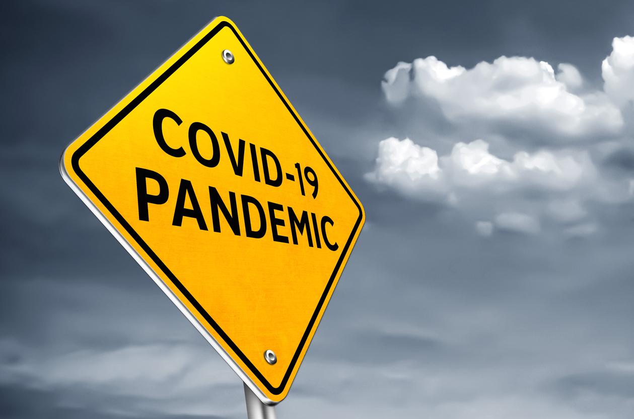 COVID 19 pandemic - roadsign message stock photo