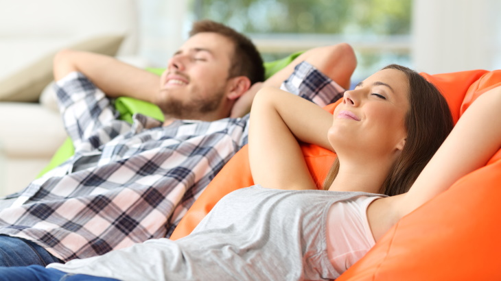 couple relaxing in new apartment