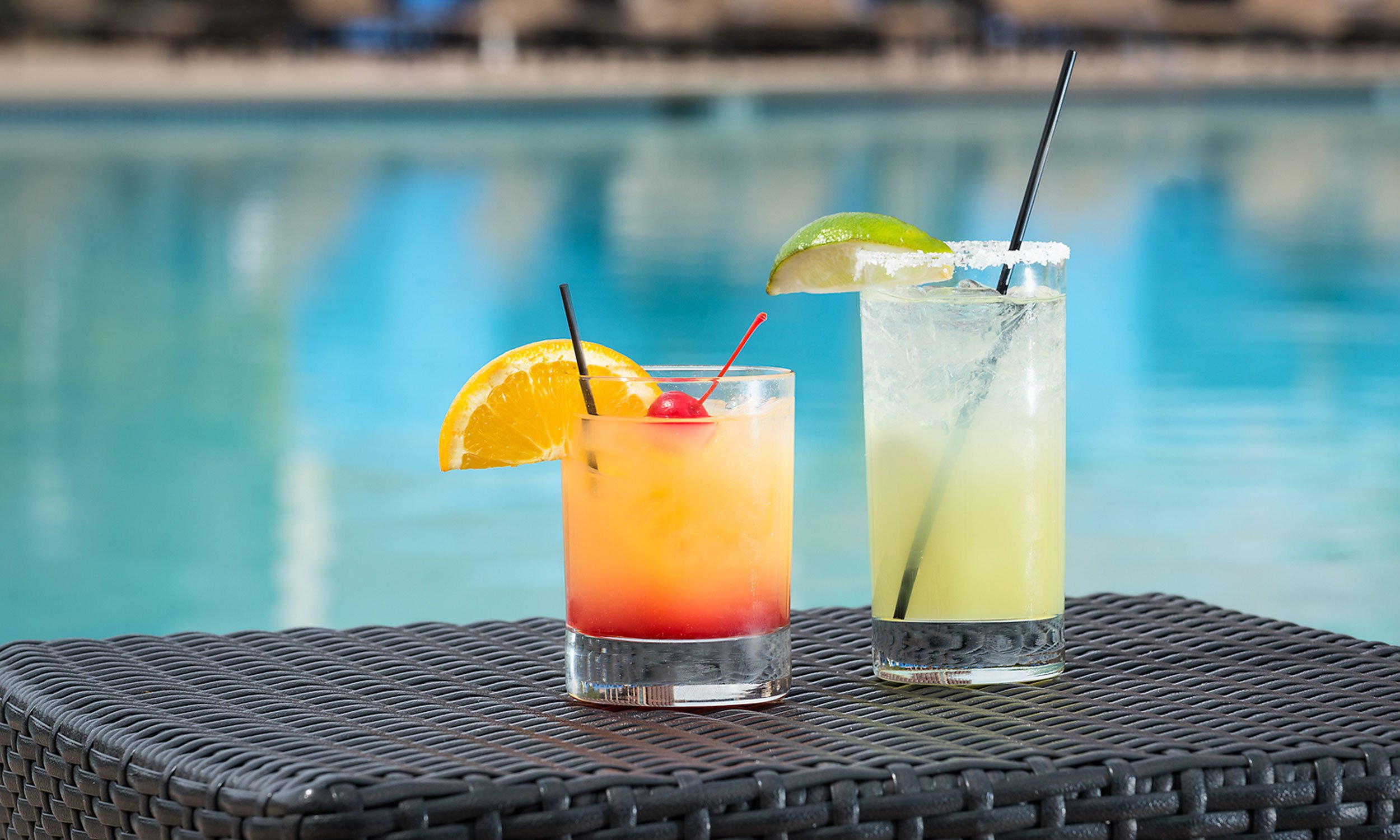 pool drinks and seating at august court in houston