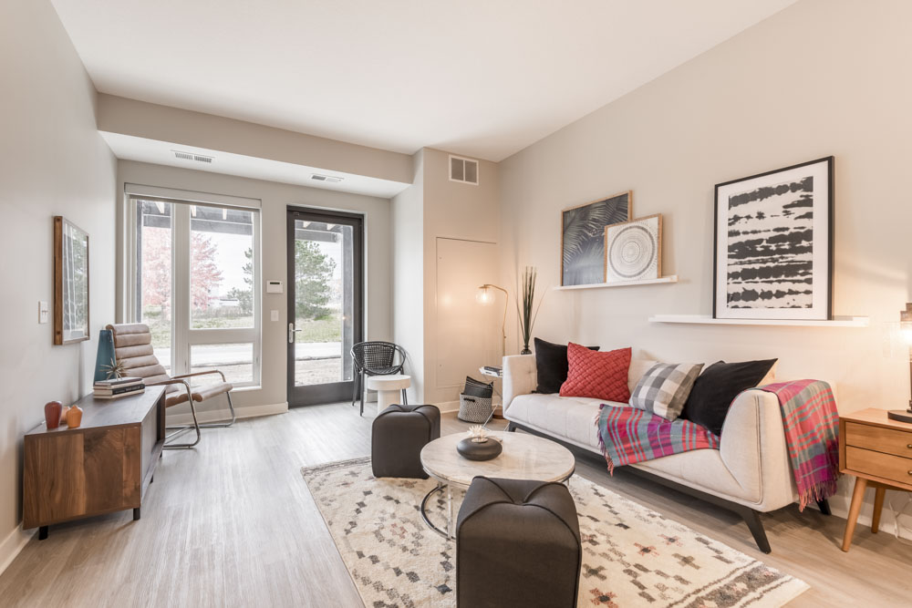 Living room with modern furnishing and abundant natural light at The Preserve at Normandale Lake