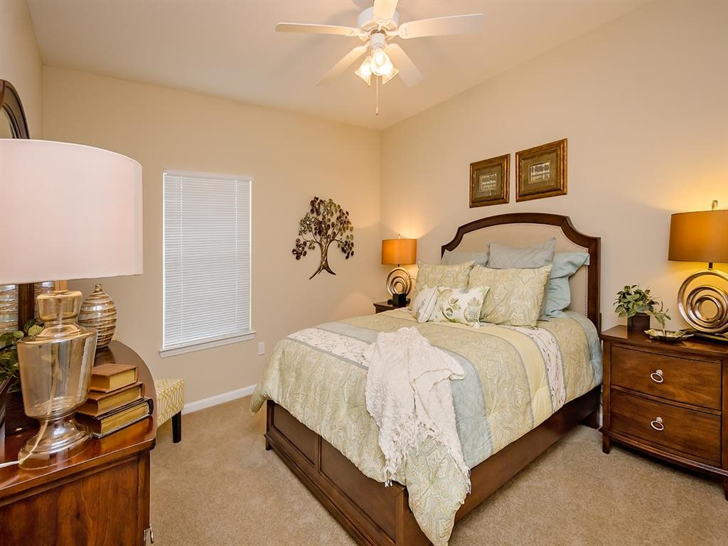 Fully furnished bedroom at Cypress Cove Apartment in Mobile, AL.
