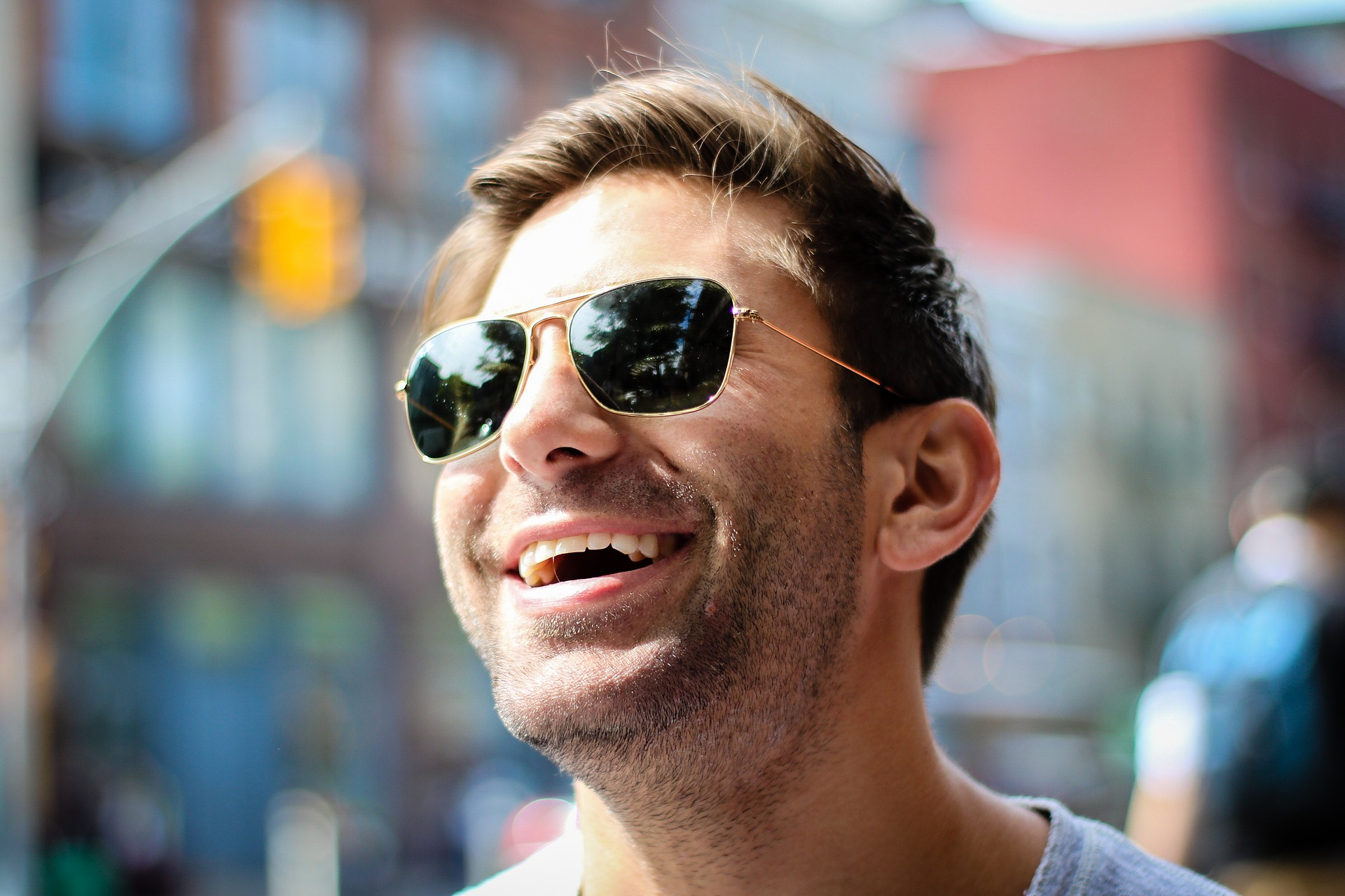 man smiling in the sun