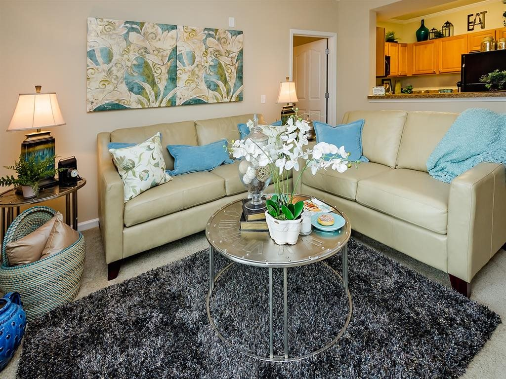 Furnished living room at Cypress Cove Apartments.