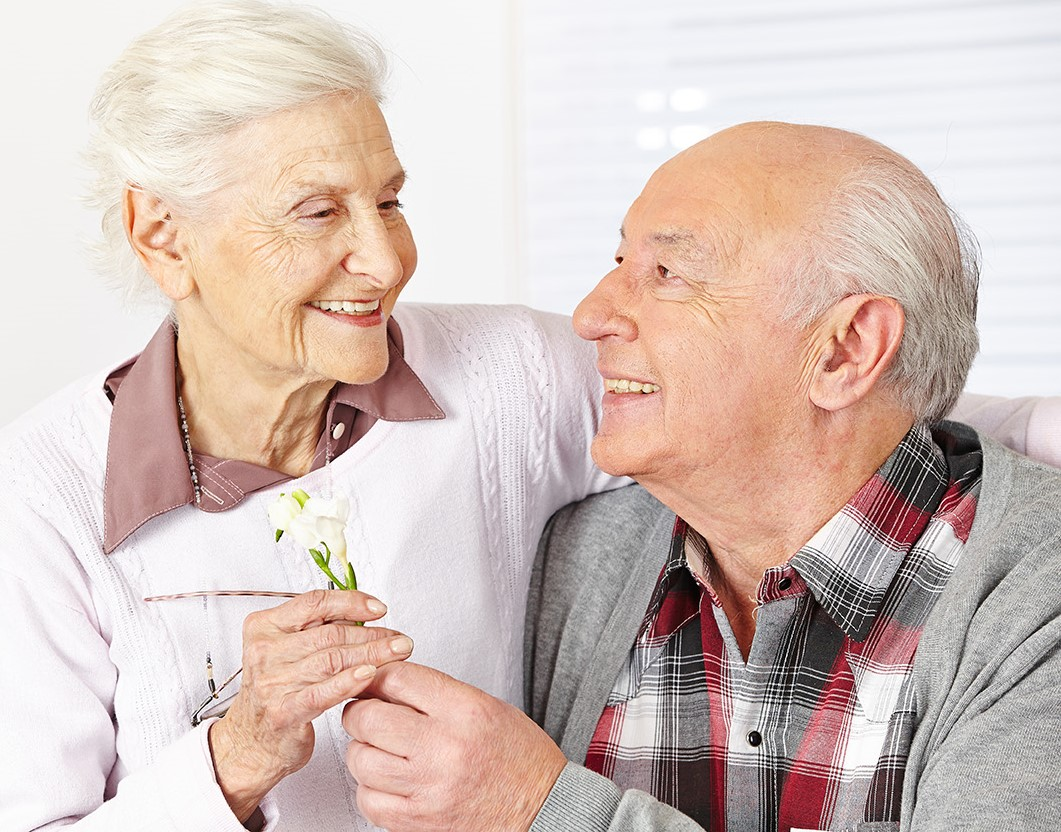Happy senior citizens in respite care