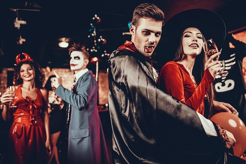 young couple at Halloween party