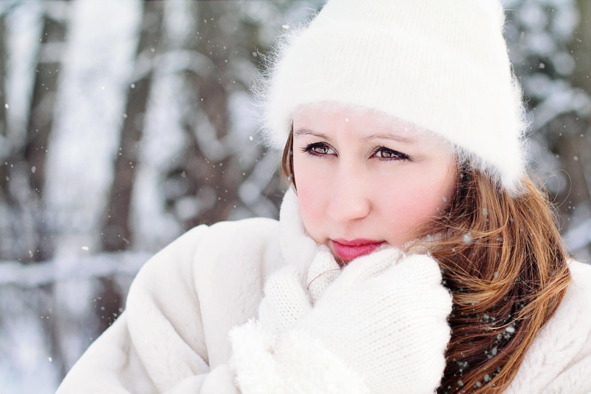 Woman in winter wear in snow