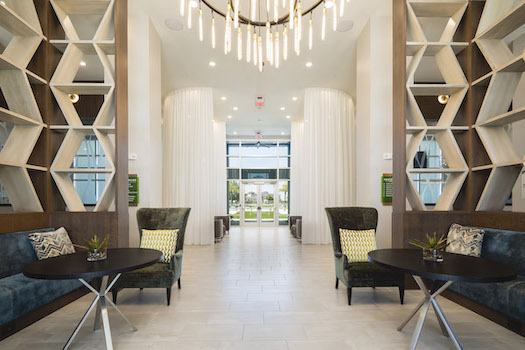 luxurious lobby at residences at the green with chandelier and seating