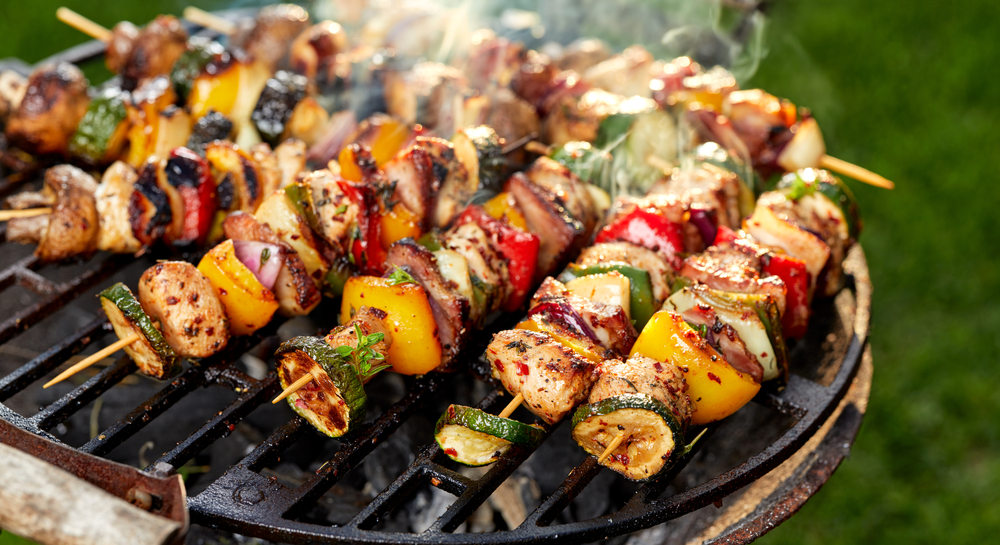 Throwing kebabs on the BBQ at the grilling station is a delicious way to celebrate summer in your Weidner Apartment community.