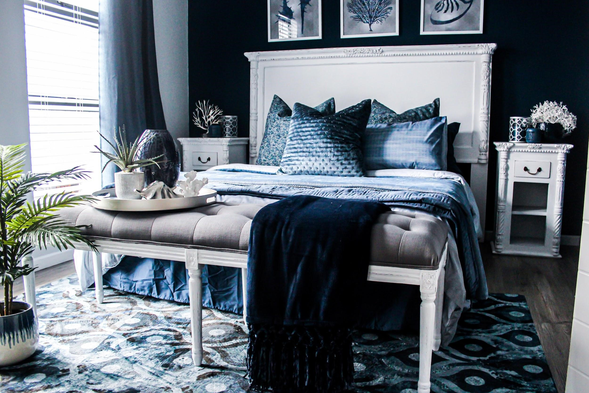 bedroom with a large bed and luxurious blue décor