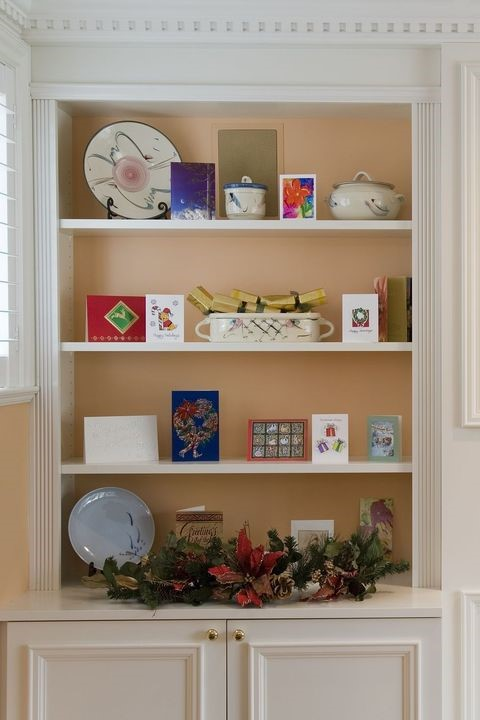 open shelves with holiday cards