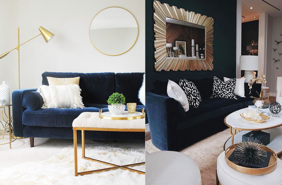 room with dark blue couch and walls with rose gold accents