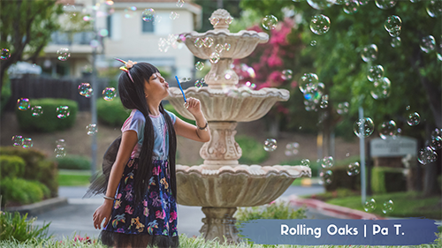 Young Girl Blowing Bubbles at Rolling Oaks Apartment Homes
