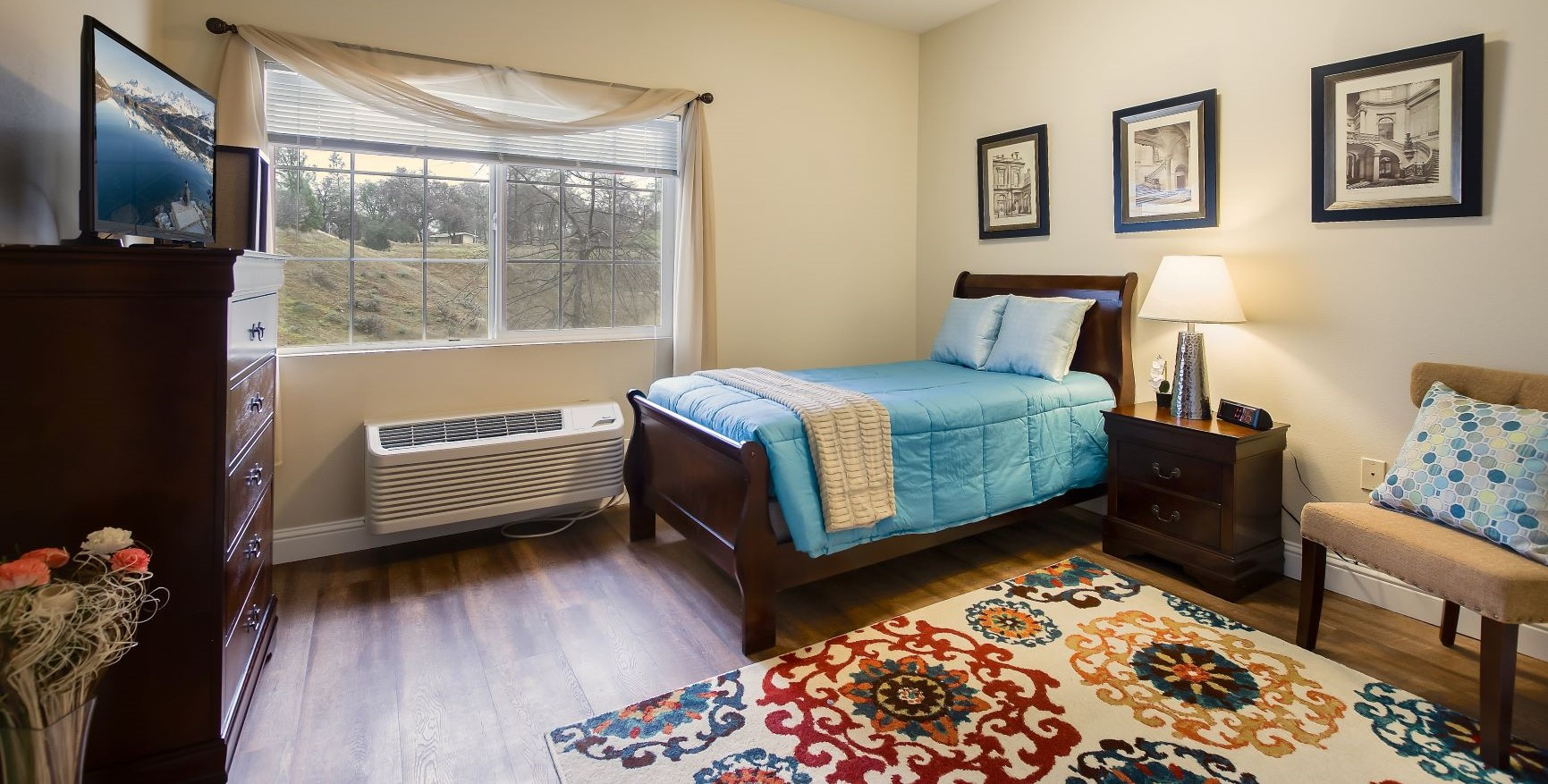 One of the gorgeous bedrooms at Pacifica Senior Living Country Crest.