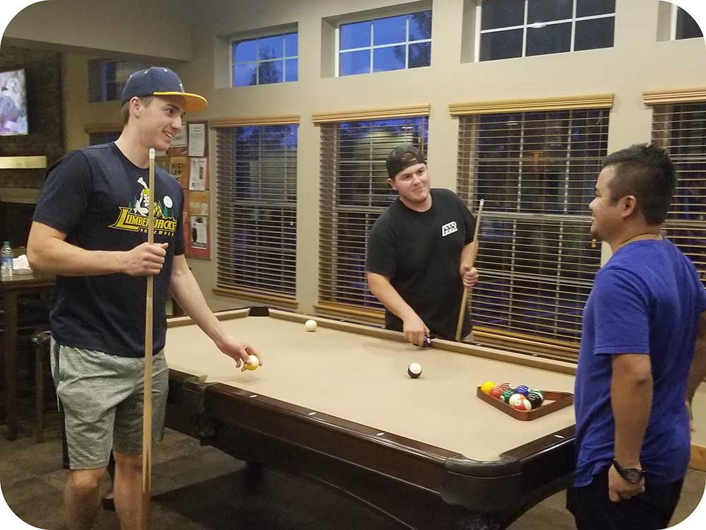 Residents playing a game of pool in the clubhouse.