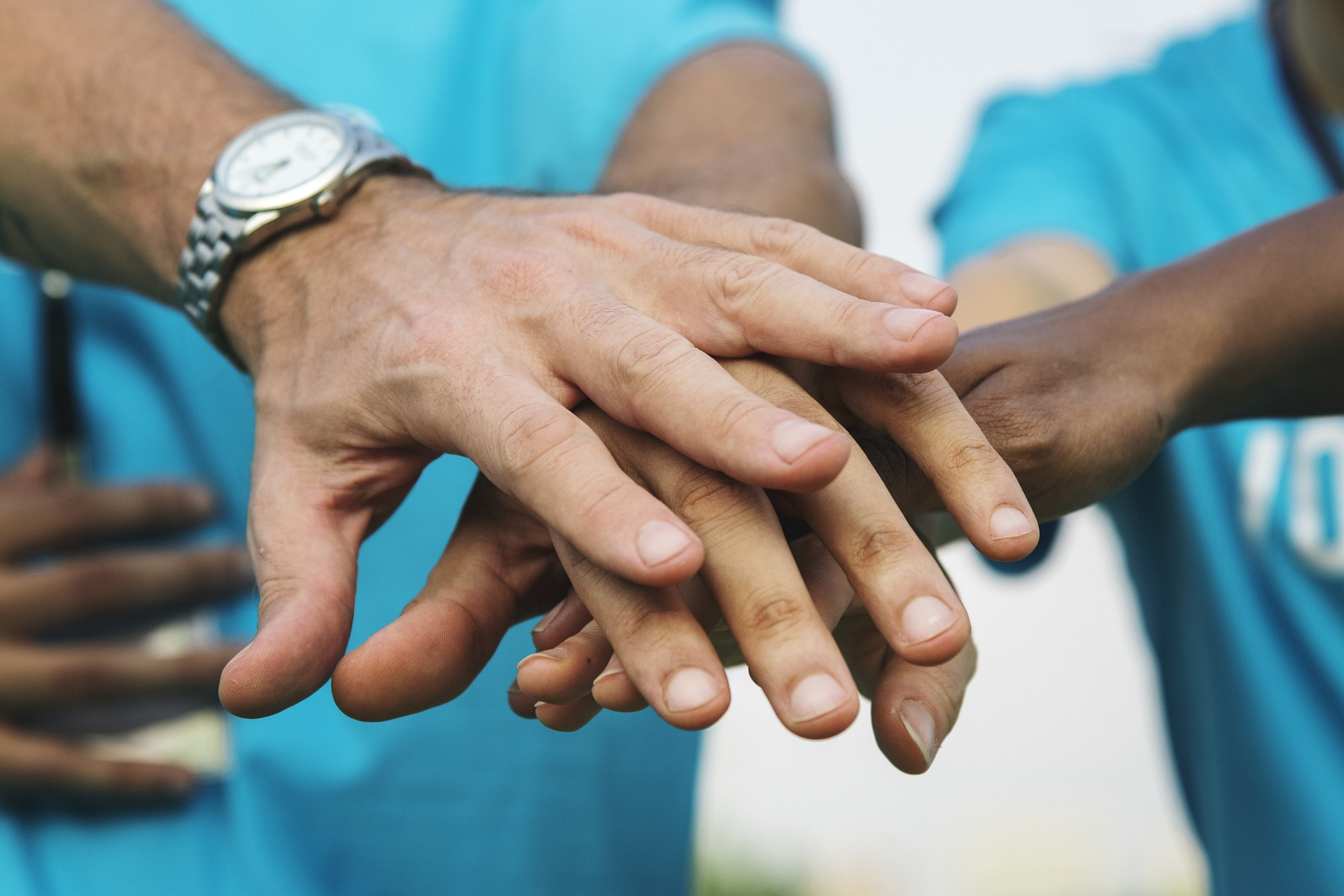 Hands in A Circle Depicts Teamwork