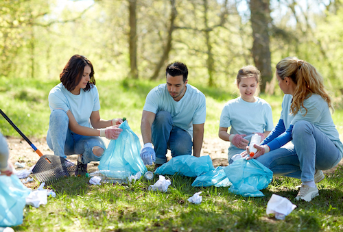 volunteer to pick up trash in the park