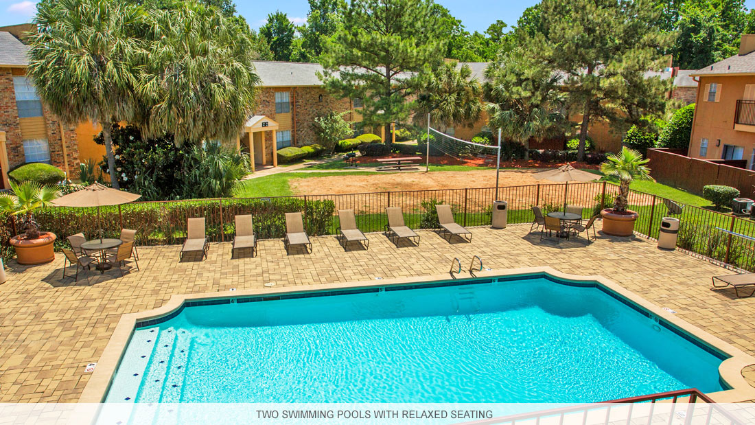 Shreveport apartment complex with two pools and relaxed seating