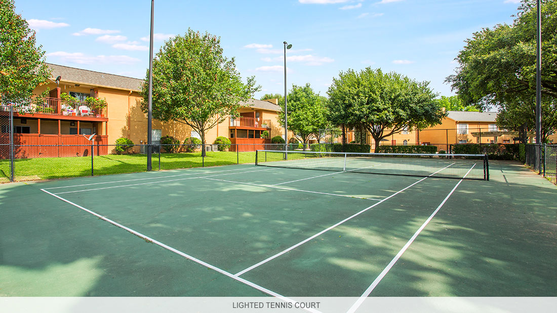 Louisiana apartment complex with lighted tennis court