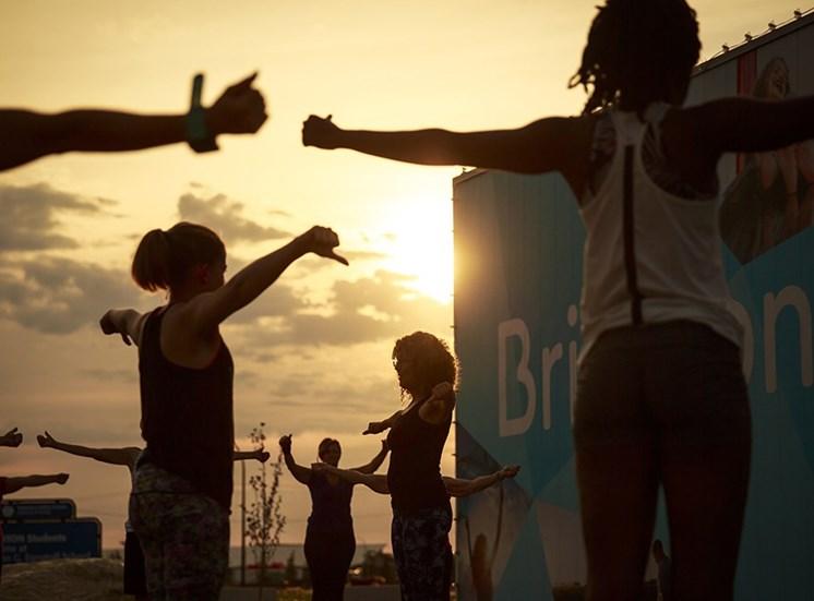 Evening yoga classes outdoors in Brighton.