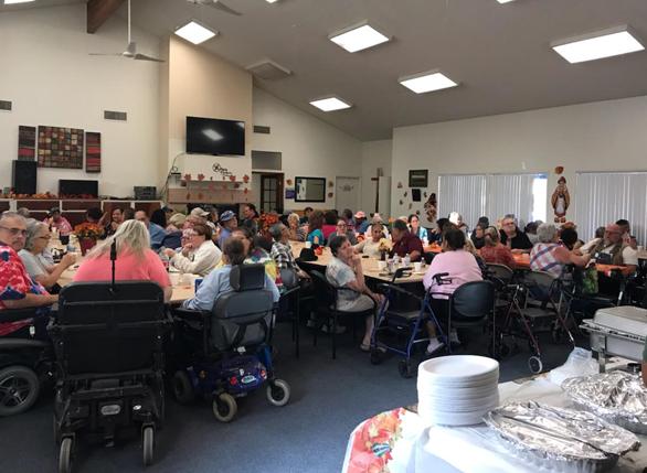 Whispering Fountains Riverside Staff hosting Tenants for a Thanksgiving Dinner