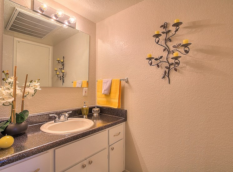 Solid Cultured Marble Bathroom Counter Tops at Eagle Point Apartments, Albuquerque, NM