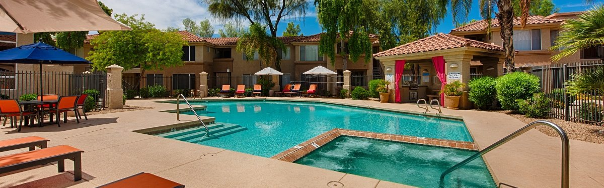 outdoor pool area with sunshine at apartments in mesa arizona