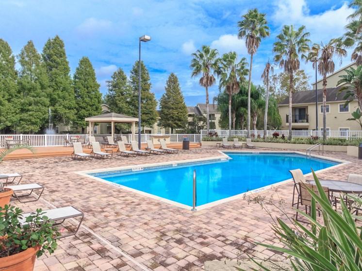 nice cobblestone lounge area around swimming pool