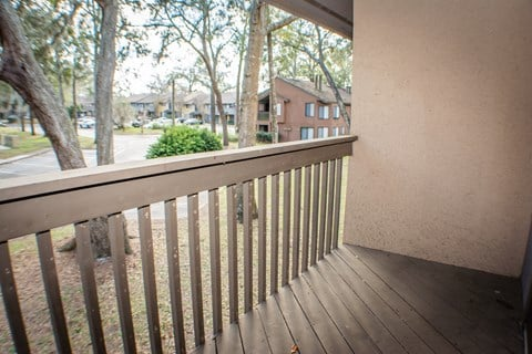 Patio with Railing at Laurel Grove Apartment Homes, Orange Park, Florida