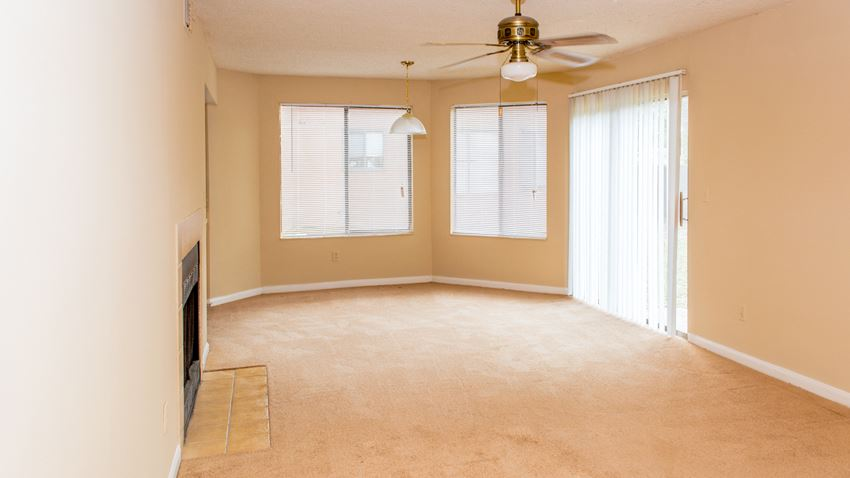 Living room with ceiling fan at Bluff House Apartment Homes, Orange Park, FL, 32073