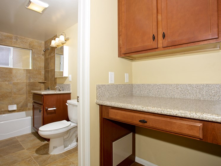 Bathroom With Adequate Storage at Woodlawn Gardens Apartments, Chula Vista, California