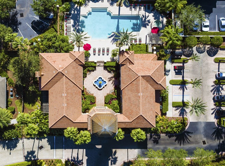 Aerial shot of clubhouse, courtyard and pool