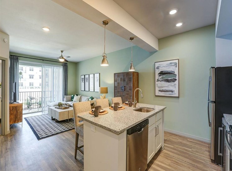 Kitchen and Living Room in one bedroom model apartment at Inspira, Florida