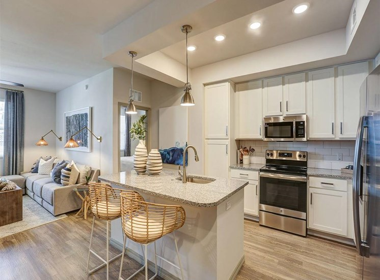 Kitchen in two bedroom model apartment at Inspira, Naples