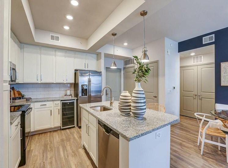 Kitchen with island and pendant lighting at Inspira, Naples, Florida