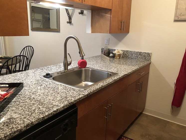 Fitted Kitchen With Island Dining at Walker Estates Apartments, Augusta, GA, 30906