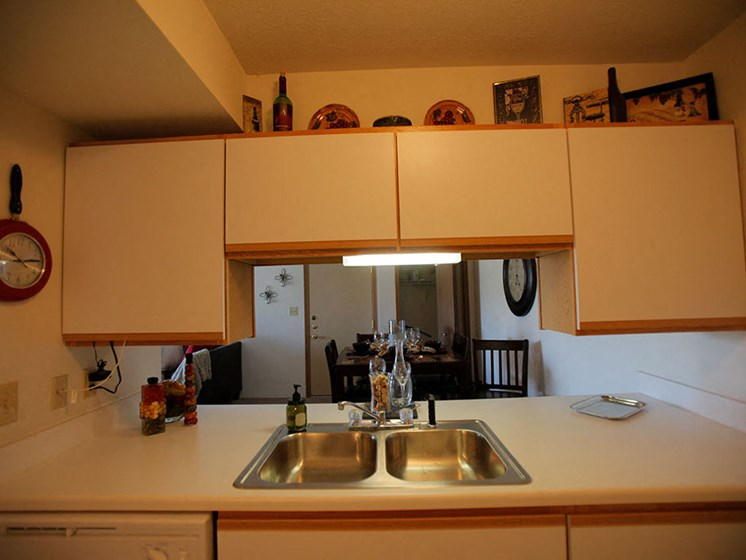 Fully Furnished Kitchen With Stainless Steel Sinks at Van Horne Estates Apartments, El Paso, Texas