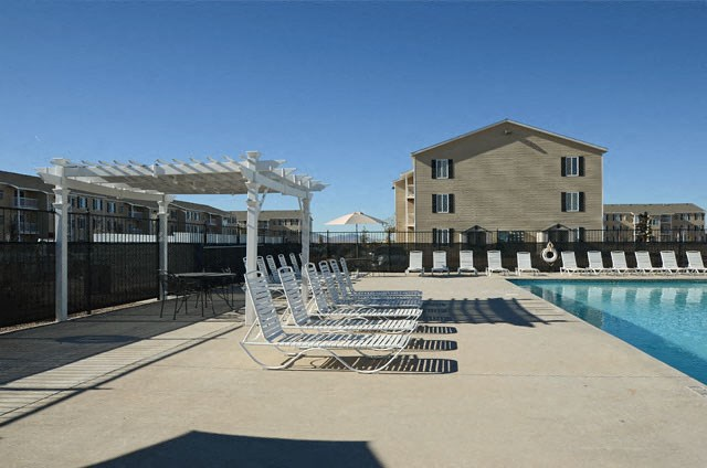 Swimming Pool And Relaxing Area at Van Horne Estates Apartments, Texas