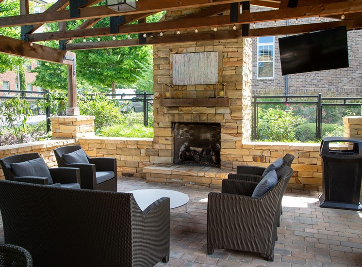 Woodstock West by Walton Apartment Homes  Outdoor Fireplace
