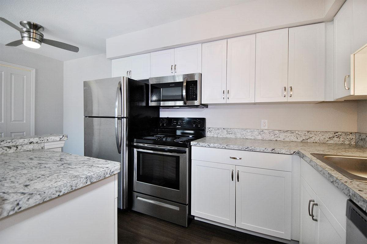 Bloomfield Place Apartments Kitchen with White Cabinets