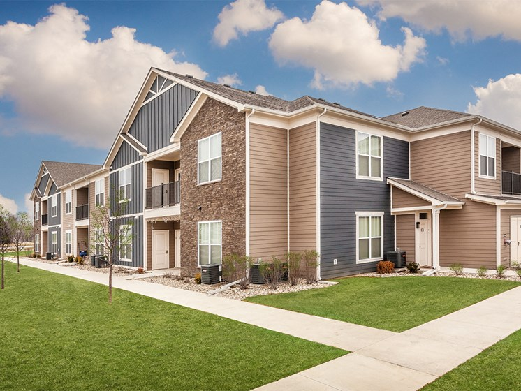Apartments Goshen - Park Thirty-Three Apartments Exterior with Landscaped Walkways and Beautifully Maintained Homes