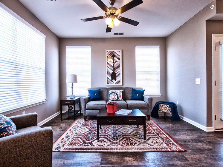 Apartments for Rent Goshen, IN - Park Thirty-Three Apartments Living Room with Wood-Style Flooring, Multiple Windows, and Ceiling Fan
