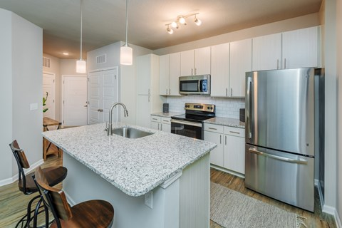 Greenville SC Apartments-Trailside Verdae Apartments Kitchen With Wood-Style Flooring And Spacious Granite Island