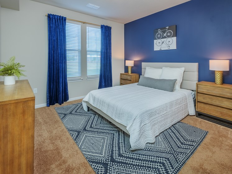 Apartments for Rent in Greenville-Trailside Verdae Apartments Carpeted Bedroom With Wooden Furnishings And Plush Bedding