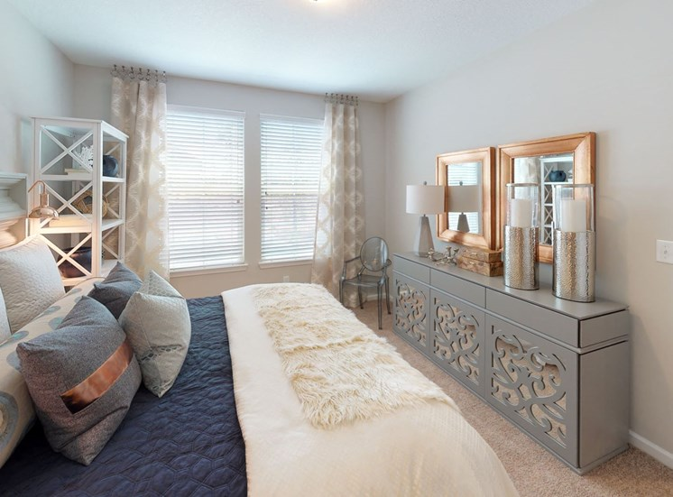 Spacious guest bedroom with nice natural lighting