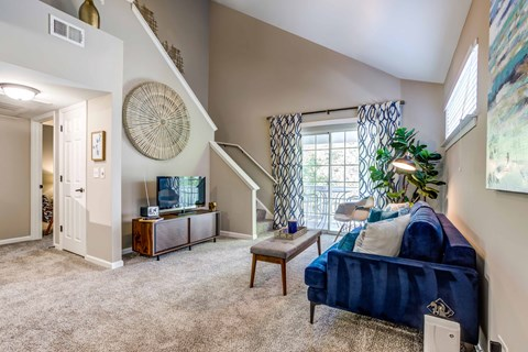 Legacy at Fox Valley Living Room with Plush Carpet Flooring and Sliding Glass Door Access to Patio or Balcony