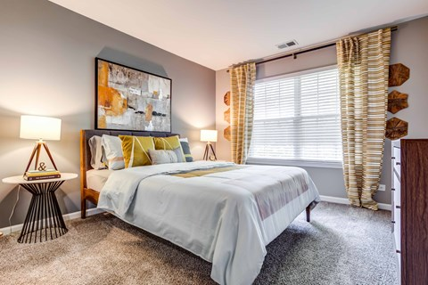 Legacy at Fox Valley Queen Sized Bedroom with Carpet Flooring and Large Window with Coverings