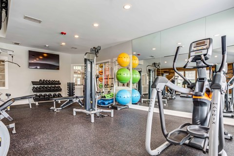 fitness center with equipment and exercise balls