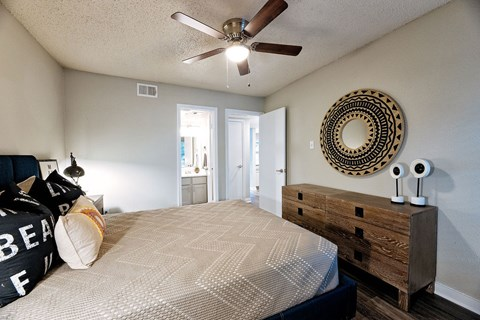 Motif South Lamar Bedroom with Wood-Style Plank Flooring and Ceiling Fan