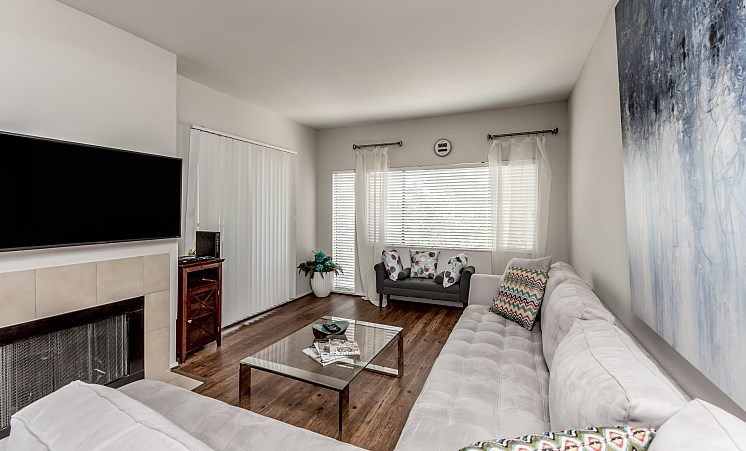 Living Room With Television and Fireplace at Augusta Court Apartments, Houston, TX, 77057