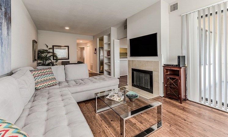 Living Room With Expansive Window at Augusta Court Apartments, Houston, TX, 77057
